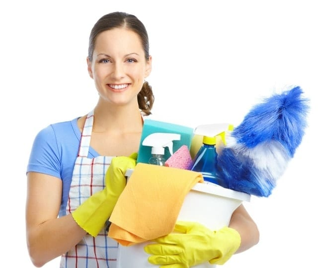 Woman carrying cleaning supplies start cleaning business