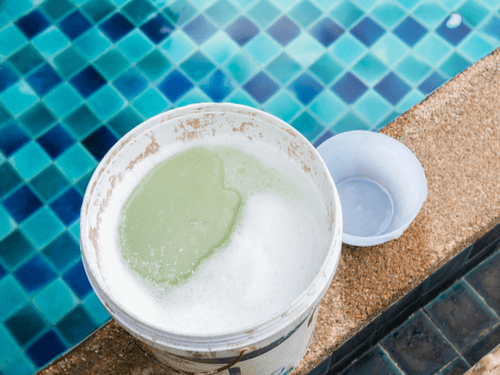 Chlorine in Bucket for Pool Treatment - Chlorine Beach Illustration