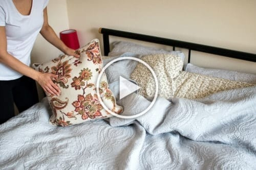 LetsMakeaBed - woman puts pillows on bed