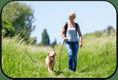 woman out walking dog