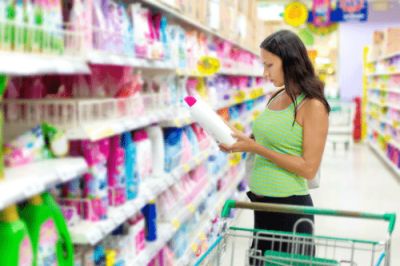 Woman buys cleaning supplies from store