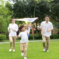 Memorable Moments Family Flying a kite